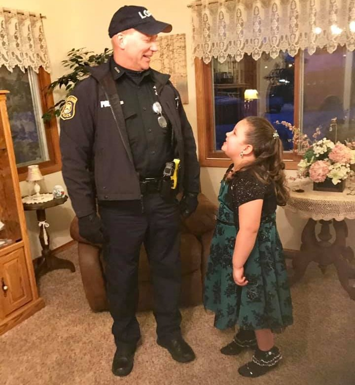 LOPD officer makes a special memory for Blanche Sims student at Daddy-Daughter dance