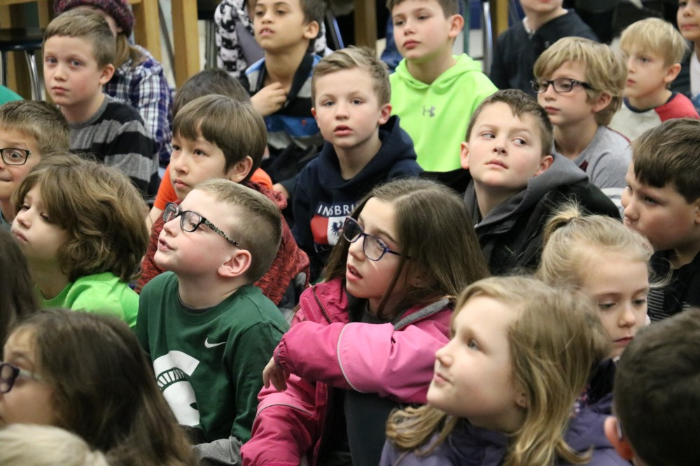 Students watching at assembly
